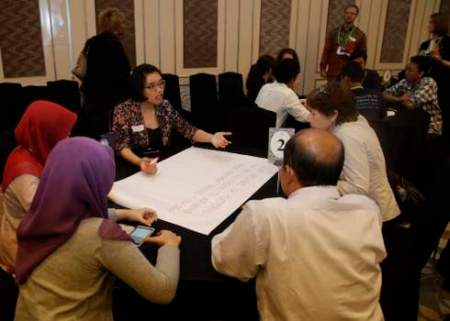 A participant leads a discussion during a special youth session at Forests Asia Summit