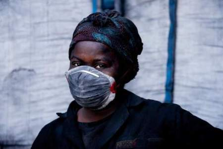 Woman at charcoal factory